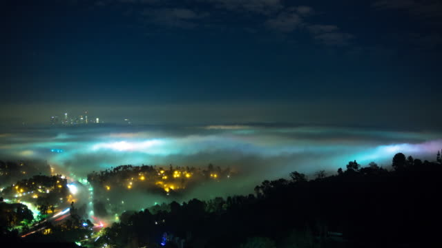 Los Angeles Cityscape from Hollywood Hills in Fog - Time Lapse video
