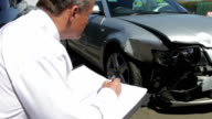 Loss Adjuster Inspecting Car Involved In Accident video