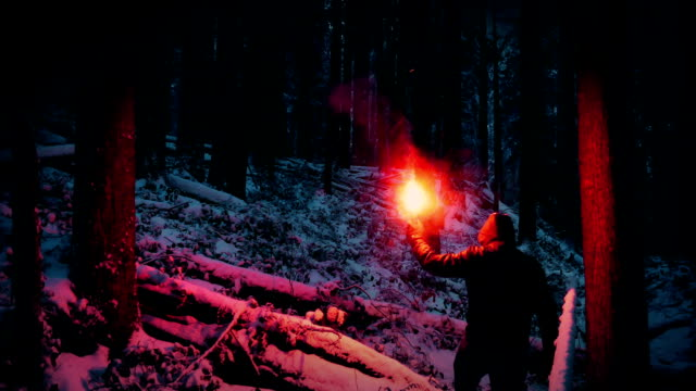 Lost Man Walking With Flare In Snowy Wilderness video