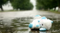 Lost Toy In A Puddle Under Rain video
