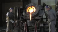 Lost wax bronze casting in a foundry video