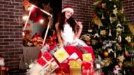 lot Christmas gift, portrait, pretty girl Santa Claus video