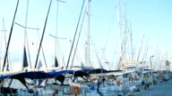 A lot of beautiful sailing yachts and catamarans moored to the pier in the Greek marina in Athens, the Mediterranean Sea, a clear summer morning. View from the pier video