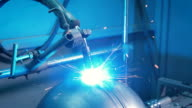A lot of bright sparks scatter in different directions from the workplace of electric welding machine. Modern automated equipment at the plant for the production of metal parts video
