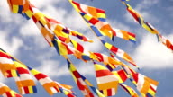 A lot of Buddhist flags waving on the wind with blue sea background in Thikse Monastery, India video