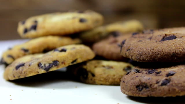 Lot of chip cake cookies with chocolate close-up tilting video