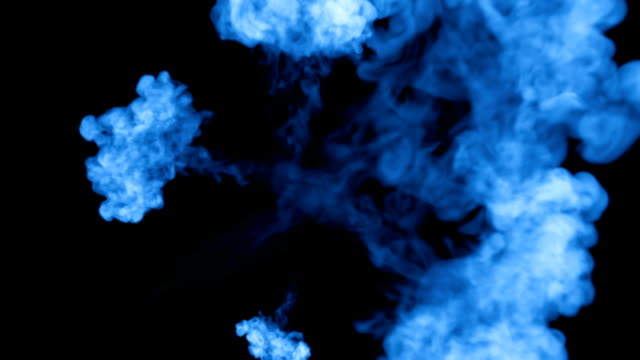 A lot of flows of fluorescent blue ink or smoke, isolated on black in slow motion. Blue tint spread in water. Use for ink background, ink effects. Alpha channel is on use luma matte as alpha mask video