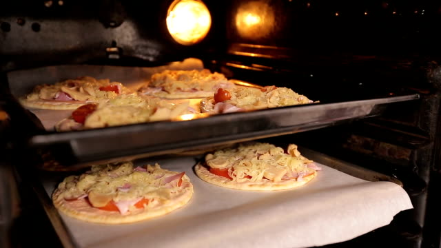 Lot of pizzas in the oven waiting for his time video