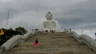 A lot of turists take photos near monument of Big Buddha in Chalong Phuket Thailand video