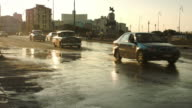 Lots of classic cars driving in golden hour sunset in Havana video