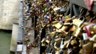 Lots of love locks on the brigde in Paris video