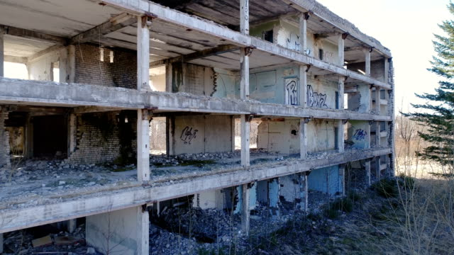 Lots of writings on the abandoned building video