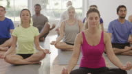 Lotus Position in Yoga Class video