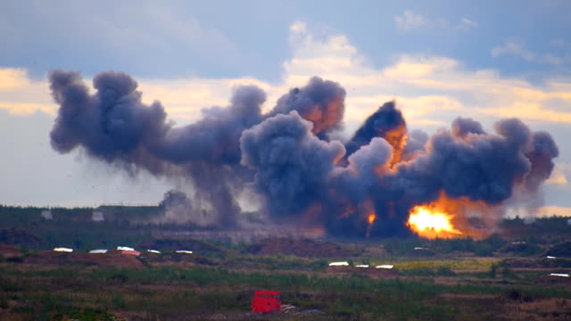 Loud explosions from artillery barrage  on the range on military exercises video