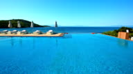 Lounge chairs and umbrella at pool on Skopelos island video