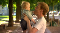 Love, father with happy baby son. video