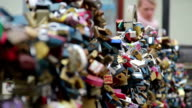 Love locks on a bridge, lovers padlocks hanging enormous amount. Beautiful shot of Europe, culture and landscapes. Traveling sightseeing, tourist views landmarks of Czech Republic. World travel, west European trip cityscape, outdoor shot video