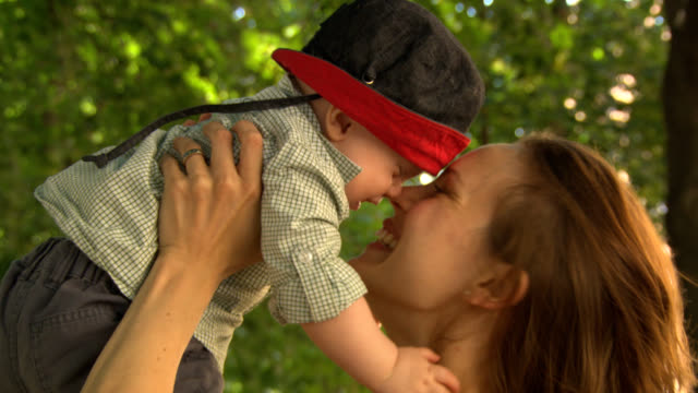 Love, mother with baby son. video