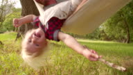 Lovely dad plays with his blond child on a hammock video