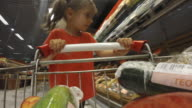 POV Lovely little girl choosing vegetables at greengrocery video