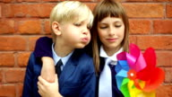 Lovely siblings with pinwheel video