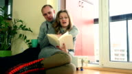 lovely wife and husband spent time together near warm radiator on cold day. video