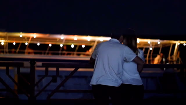 lovers are waiting for the ship - at night in the summer video
