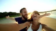Lovers capturing summer holiday moments video