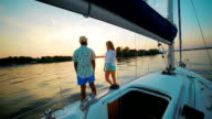 Lovers enjoy relaxing on a yacht. video