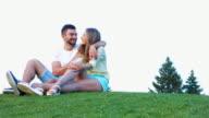 Lovers enjoying a date video