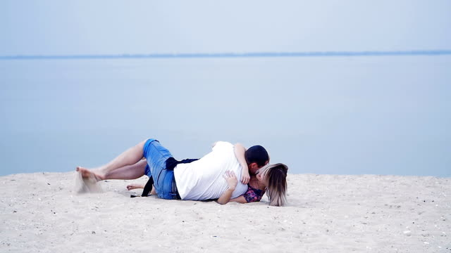 lovers lying on the sand near the sea - love story video