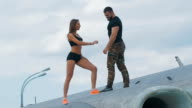 Lovers man and woman dressed in military style video