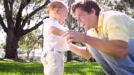 Loving Caucasian Father Fun Playing Toddler Boy Park video