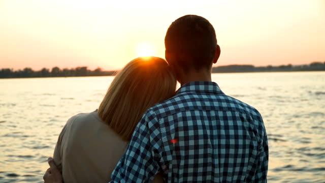 Loving couple admiring the sunset video