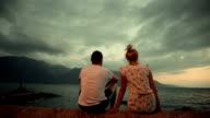 Loving couple enjoying the sunset video