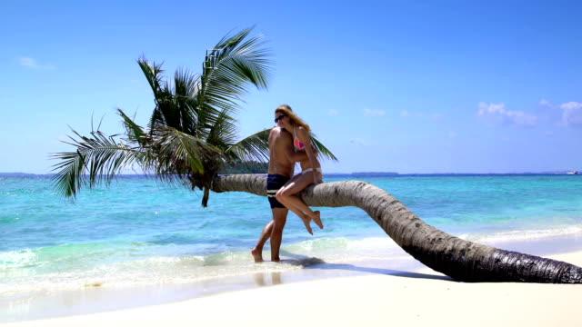 A loving couple enjoying vacation on a tropical beach. Maldives. video
