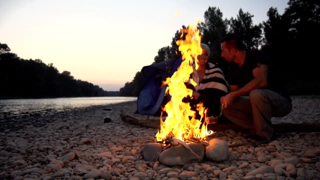 HD SUPER SLOW-MO: Loving Couple Having A Campfire video