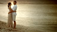 Loving couple hugging and talking by the sea video