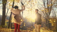 SLO MO Loving couple hugging in autumn forest video