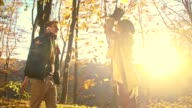 SLO MO Loving couple hugging under falling autumn leaves video