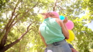 Loving couple in a park with balloons video