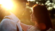 Loving couple kissing at sunset video