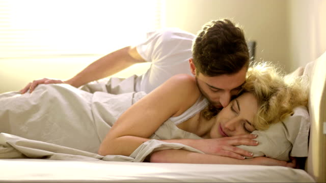 Loving Couple Kissing In Bed video