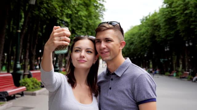 A loving couple makes selfie photo video