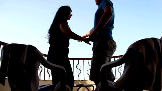 Loving Couple on the Balcony Embrace and Kiss With a View of the Sky video