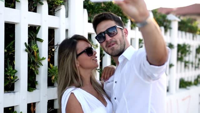 Loving couple taking selfie video