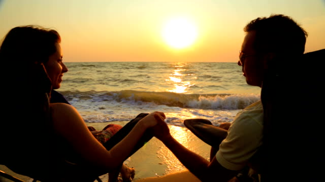 Loving Couple Talking While Sitting On Outdoor Chairs At Beach video