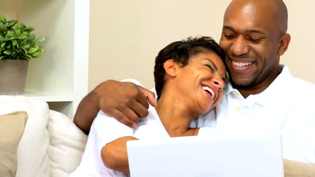 Loving Couple Using Laptop at Home video