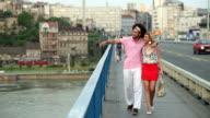Loving Couple Walking Across Bridge video