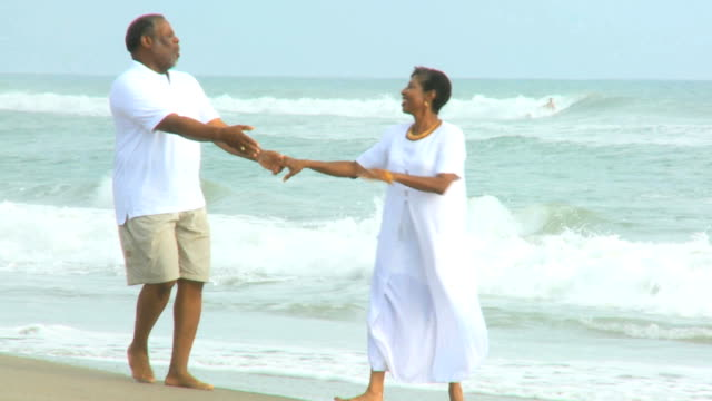 Loving Elderly African American Couple Together Beach video